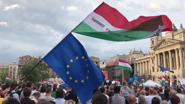 People take part in an antigovernment rally outside the Hungarian Parliament building on May 8 2018 in Budapest Hungary