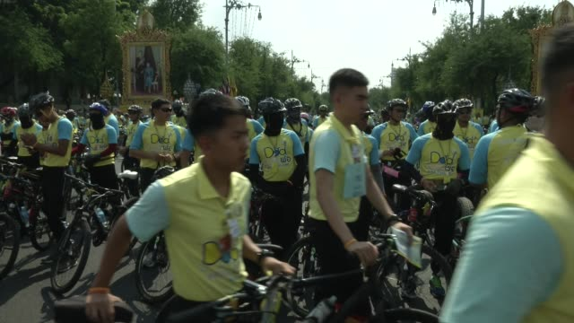 People take part in the 'Bike for Dad' event in Bangkok / Thai Crown Prince Maha Vajiralongkorn led thousands of cyclists on a 29km course in Bangkok...