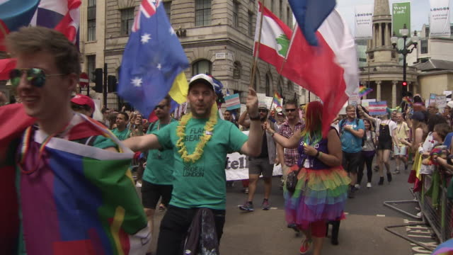 People take part in the colourful Pride march in central London