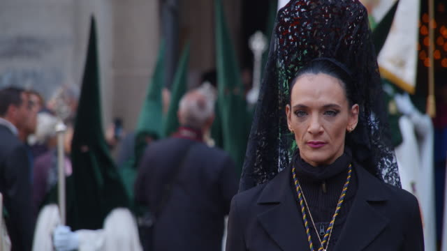 people take part in the good friday procession during the holy week in barcelona spain on april 19 2019 christian believers around the world mark the... - holy week stock videos & royalty-free footage