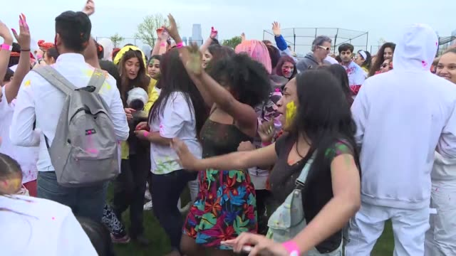 stockvideo's en b-roll-footage met people take part in the holi festival celebrations in new york united states on may 12 2018 - holi phagwa