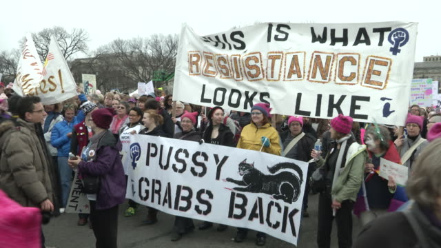 people take part in the million woman march one day after the trump inauguration in washington dc an estimated halfmillion people packed the streets... - marching stock videos and b-roll footage