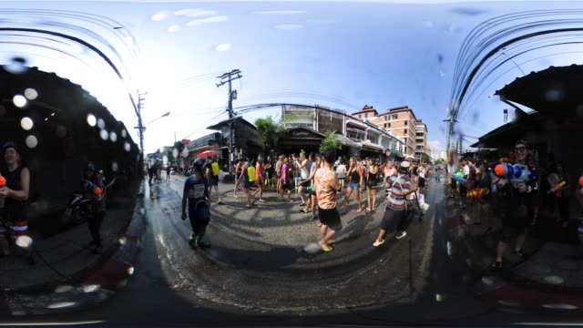 people take part in water fights during songkran or thaiu new year celebrations in chiang mai, thailand. - 水かけっこ点の映像素材/bロール