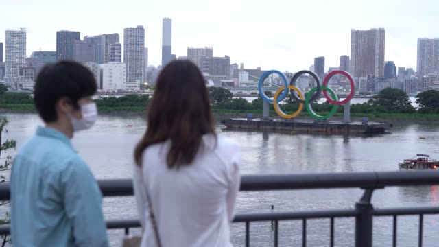 people take photographs of olympic rings on the day marking one year to go until the tokyo olympic games on july 23, 2020 in tokyo, japan. - japan stock videos & royalty-free footage