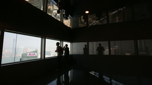 people take photos through windows inside the bank of china tower in hong kong, china, on wednesday, dec.4, 2013 tourists in the bank of china tower... - bank of china tower hong kong stock videos & royalty-free footage