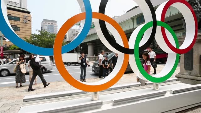 people take pictures in front of the olympic rings on july 25 tokyo japan tokyo marks one year to go 2020 olympics decorating with olympic emblems... - olympic rings stock videos & royalty-free footage