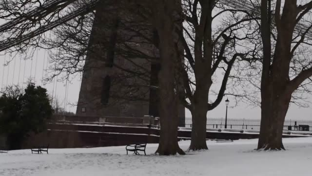 people take pictures in the snow on the clifton suspension bridge in bristol and sledge down the hill next to it - clifton suspension bridge stock videos and b-roll footage