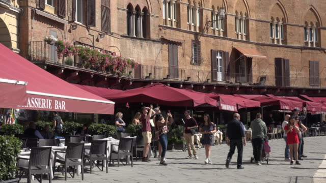 people take pictures on piazza del campo in siena - piazza del campo stock videos and b-roll footage