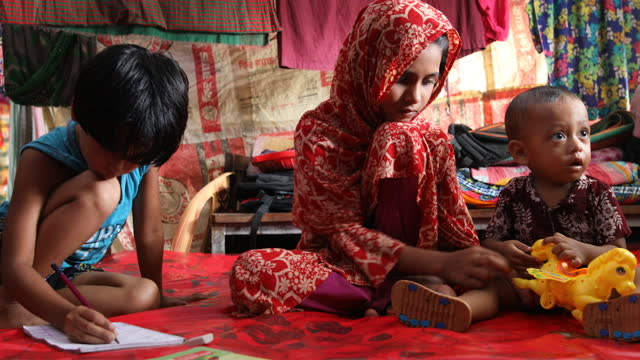 people take shelter in a schoolroom in the coastal area in bangladesh on september 24, 2020. bangladesh is one of the country's most vulnerable to... - senior women stock videos & royalty-free footage