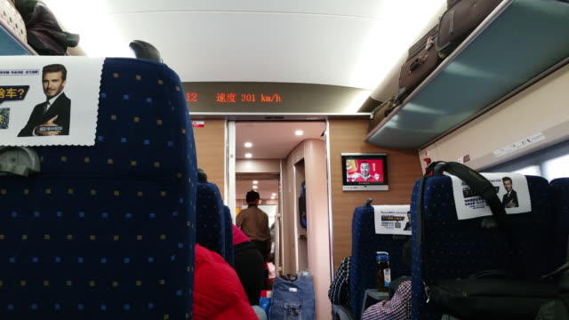 people take the highspeed bullet train from beijing to hefei at the travel rush season as families gather to celebrate the forthcoming chinese spring... - bahnreisender stock-videos und b-roll-filmmaterial