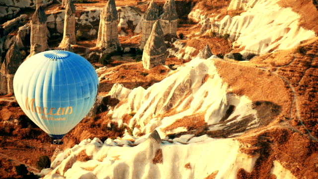 people taking colorful hot air balloons flying over red valley at cappadocia anatolia - valley stock videos & royalty-free footage