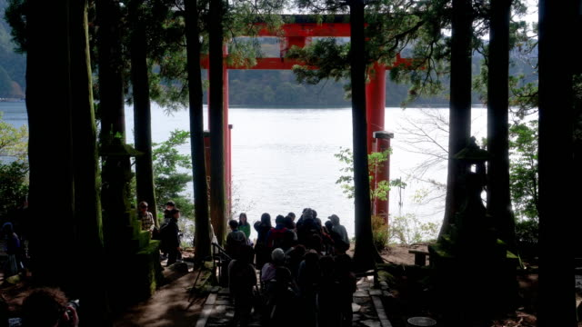 People Taking Photos at the Tori Gate on the Lakeshore