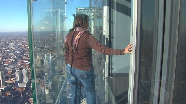 People Taking Pictures On Willis Tower Observation at Willis Tower on November 12 2013 in Chicago Illinois