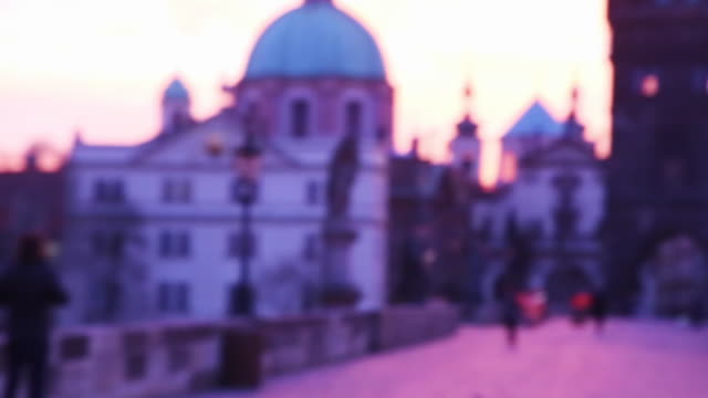 people taking pictures with smartphone during the beautiful sunrise over the prague city from the charles bridge with the city landmarks on the background. - old town bridge tower stock videos and b-roll footage