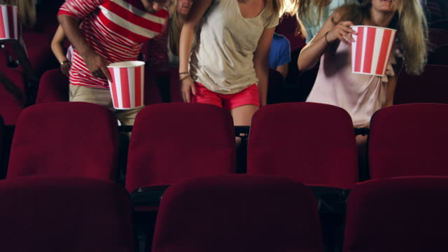 people taking seats in cinema - spelfilm bildbanksvideor och videomaterial från bakom kulisserna