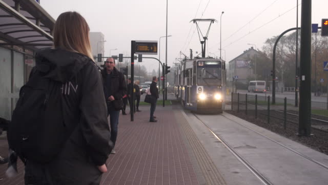 people taking tram at early morning. public transportation at krakow - routine stock videos & royalty-free footage