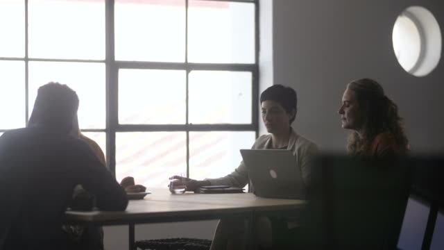 people talk at conference table, medium shot - soft focus stock videos & royalty-free footage