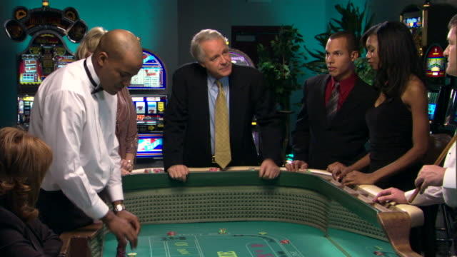 people talking at craps table in casino - casino people stock videos & royalty-free footage