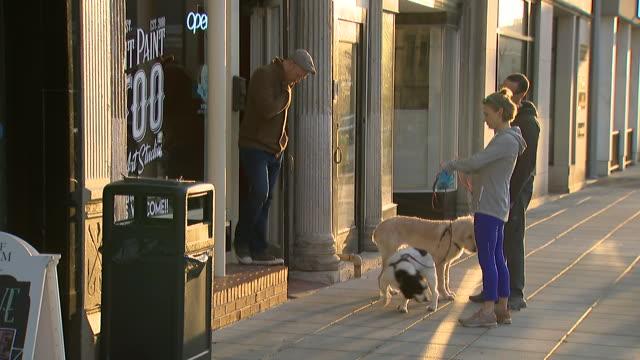 people talking to shop keeper on the street in louisville, kentucky. - 2002 stock videos & royalty-free footage