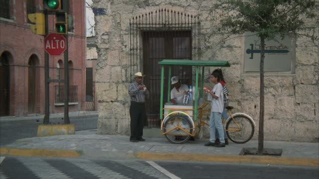 ms, people talking to street vendor selling ice cream, monterrey, mexico - selling stock videos & royalty-free footage