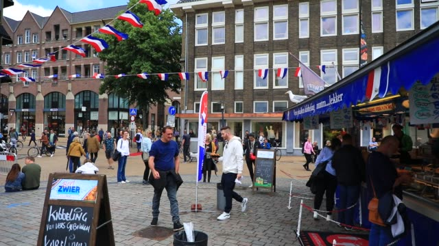 people tast traditional dutch herring at vismarkt square on july 11, 2020 in groningen. groningen is a student city. almost one in four inhabitants... - sustainable tourism stock videos & royalty-free footage