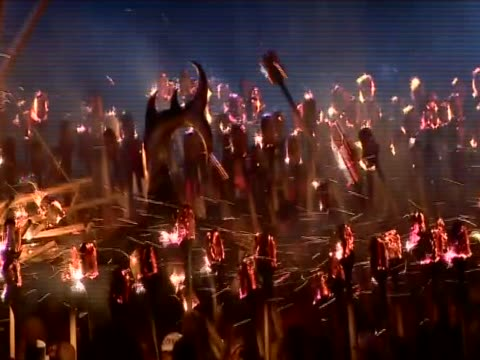 people throw flaming torches onto a replica viking galley at the culmination of the up helly aa festival - バイキング点の映像素材/bロール