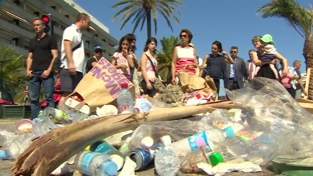 People throwing litter and spitting on a 'memorial' to the Nice terror attack perpetrator Mohamed LahouaiejBouhlel