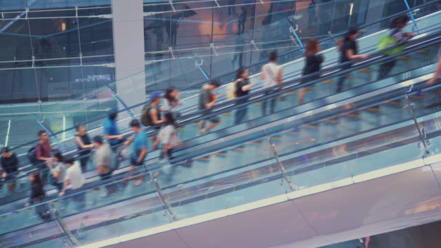people to move the escalator in shopping mall - tradeshow stock videos & royalty-free footage