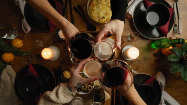 people toasting with wine and beer at christmas - dining table stock videos & royalty-free footage