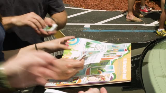 cu people trading panini world cup soccer stickers during an event at the soccer locker of miami on june 01 2014 in miami florida fans of world cup... - cup stock videos & royalty-free footage