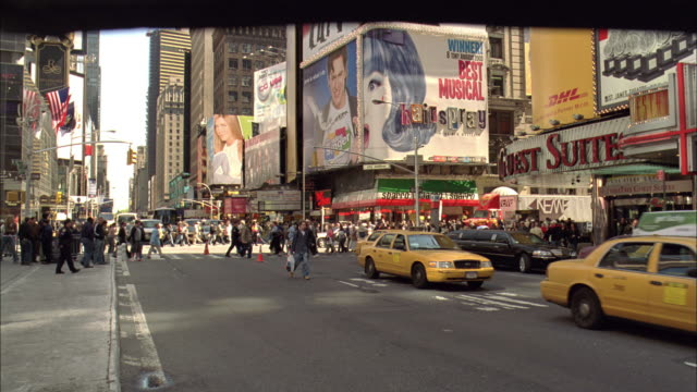 PAN People, traffic and billboards in Time Square / New York City, New York, United States