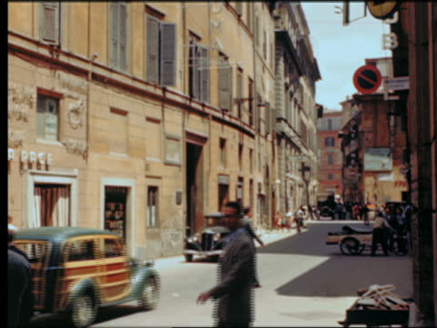 1949 people + traffic on city street / Rome, Italy