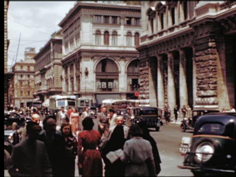 1949 people + traffic with bus on busy city street / rome, italy - 1949 bildbanksvideor och videomaterial från bakom kulisserna