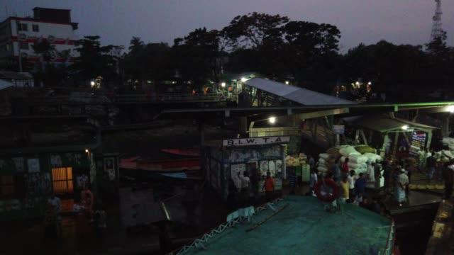 vídeos y material grabado en eventos de stock de people travel on crowded launch in coastal area of bangladesh - embarcación de pasajeros