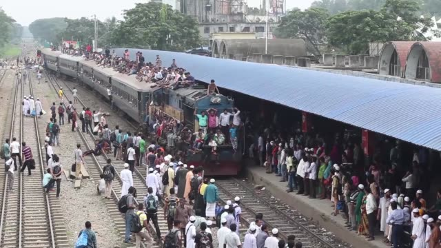people travel to their hometowns for the upcoming festival eid aladha at the airport railway station in dhaka bangladesh on september 08 2016 - september stock videos and b-roll footage
