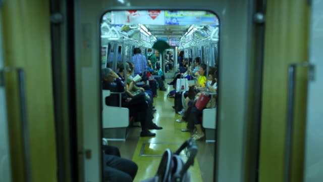 WS People traveling in crowded subway train / Tokyo, Japan