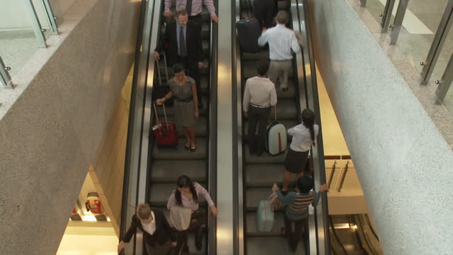ws ha people traveling on escalators / bangkok, thailand - エスカレーター点の映像素材/bロール