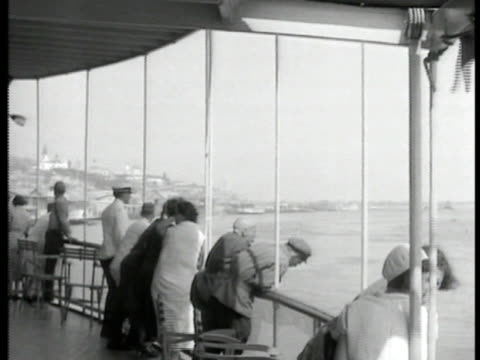 people traveling on ship on volga river steam ship whistle statue of lenin w/ people in soft focus bg - 1935 stock videos and b-roll footage