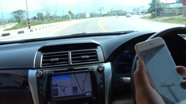 people traveling road trip with GPS technology in car, 4k