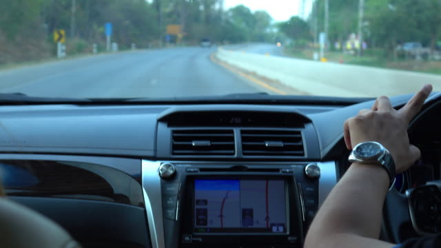 people traveling road trip with GPS technology in car