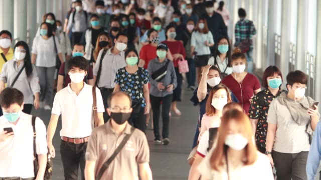 people traveling to work during the outbreak of corona virus or covid-19 to protect themselves by wearing a mask to prevent infection. - south east asia stock videos & royalty-free footage