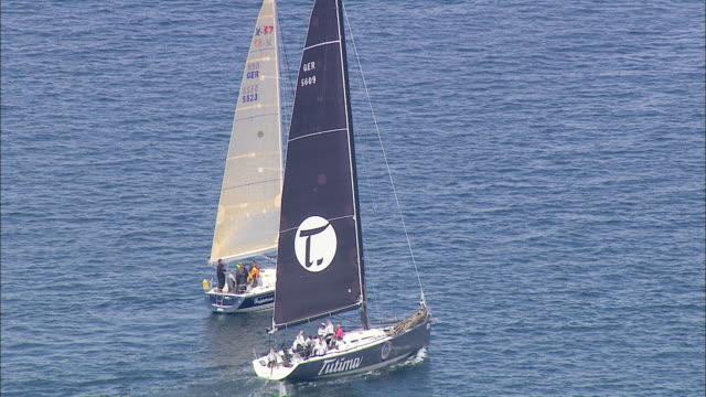 aerial ms people travelling in sailboat / kiel, schleswig-holstein, germany - schleswig holstein stock-videos und b-roll-filmmaterial