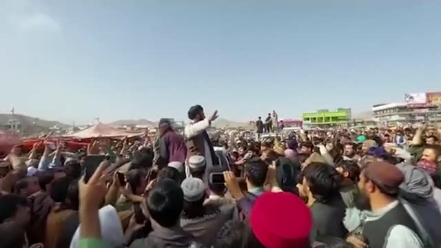 people try to flee despite taliban reassurances that there would be no revenge attacks; afghanistan: kabul: int car taliban fighters along riding in... - afghanistan stock videos & royalty-free footage
