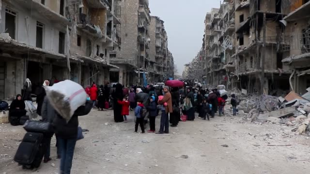 people, under siege and heavy bombardment of syrian regime, from aleppo call major power and political leaders to get an action to stop massacre in... - 大量殺人点の映像素材/bロール