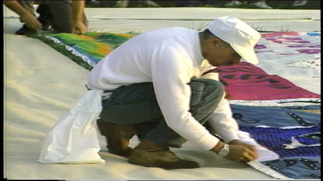 people unwrapping aids quilt on great lawn - 1987 stock videos & royalty-free footage
