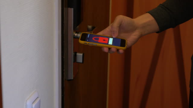 People use smartphone to control the door. Smart home and home automation technology