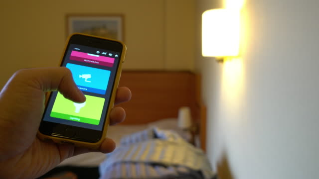 People use smartphone to control the light at Bed room