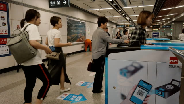 people using app device on smartphone or card to pay for subway ride - tapping stock videos & royalty-free footage