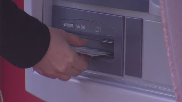 ktxl people using atm at bank of america - bank of america stock videos & royalty-free footage