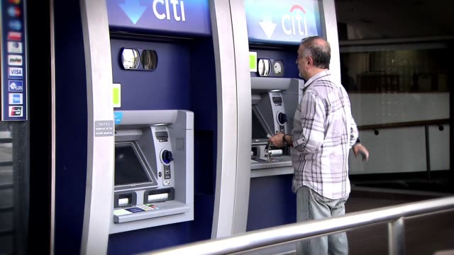 people using atm machines on august 05 2013 in los angeles california - bank of america stock videos & royalty-free footage